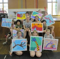 group photo with paintings